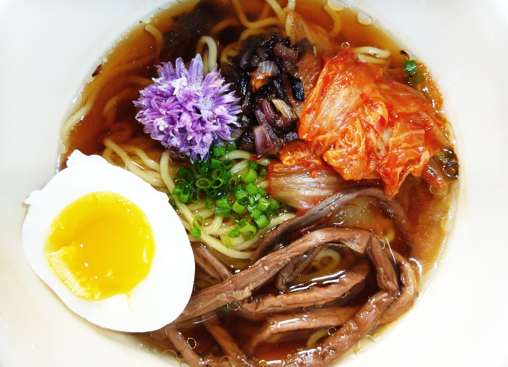 shoyu ramen with kimchi soft cooked egg onion flower fern
